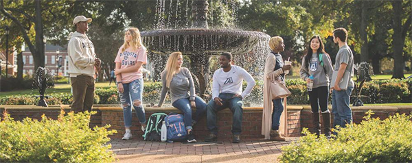 Students standing around the fountain