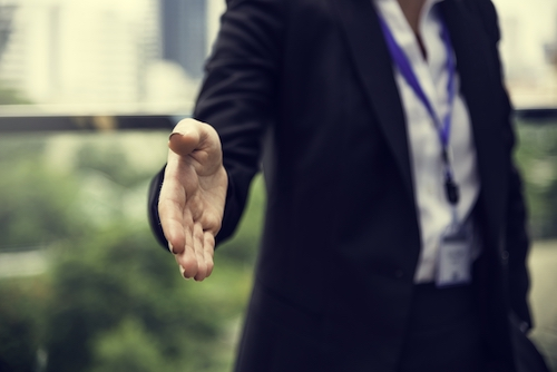 Person offering a handshake