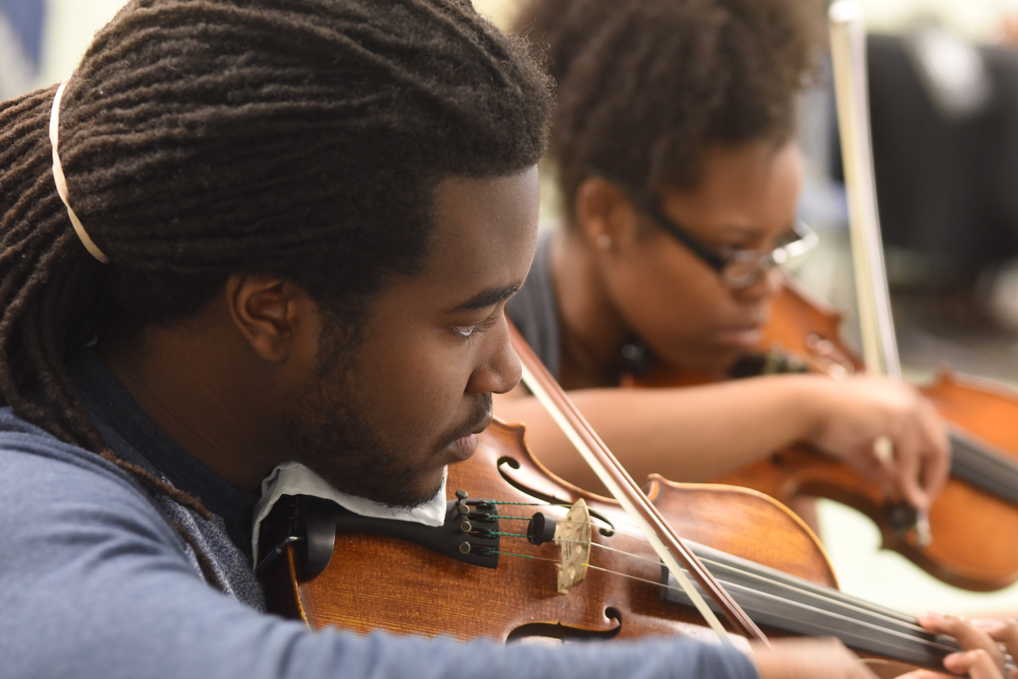 Students playing violins within the Department of Music at Augusta University